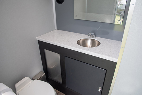 A stall from one of our 4-stall VIP restroom trailers .
